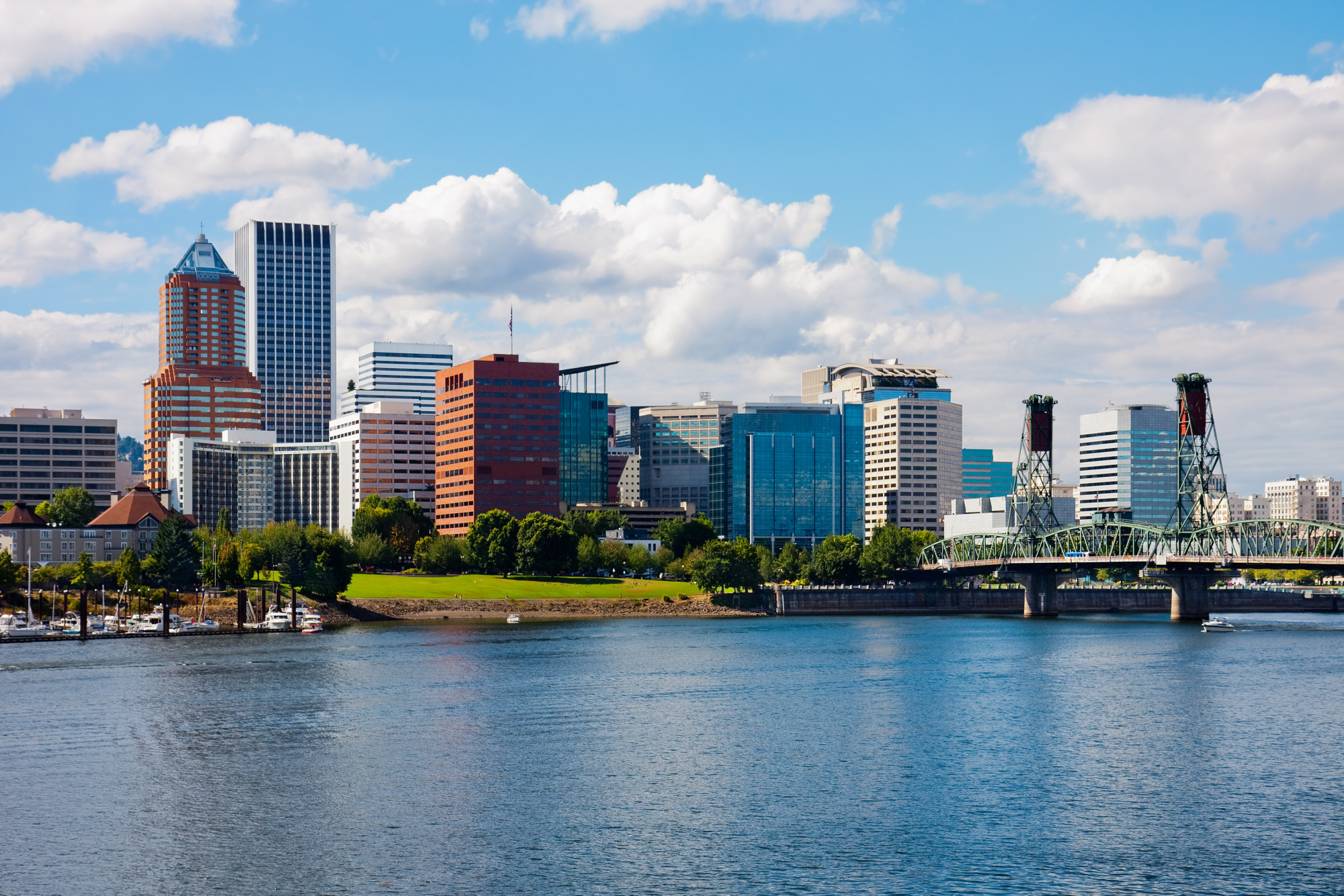 A picture of downtown Portland, Oregon across from the river on a sunny summer day.
